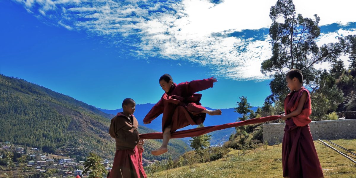 witness the happy bhutanese kid while touring with us